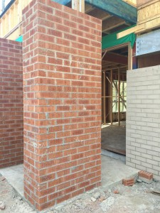 Front post - red bricks are rendered