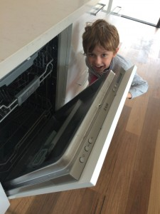 "My little man loving the ""disappearing"" dishwasher"